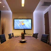 This is our meeting room. The great screen allows us to see our computers as well as the projects we present our clients.